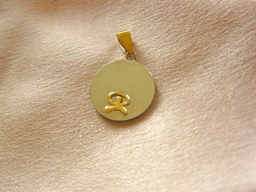 This unusual stainless steel and gold Indalo pendant is a true gift with meaning