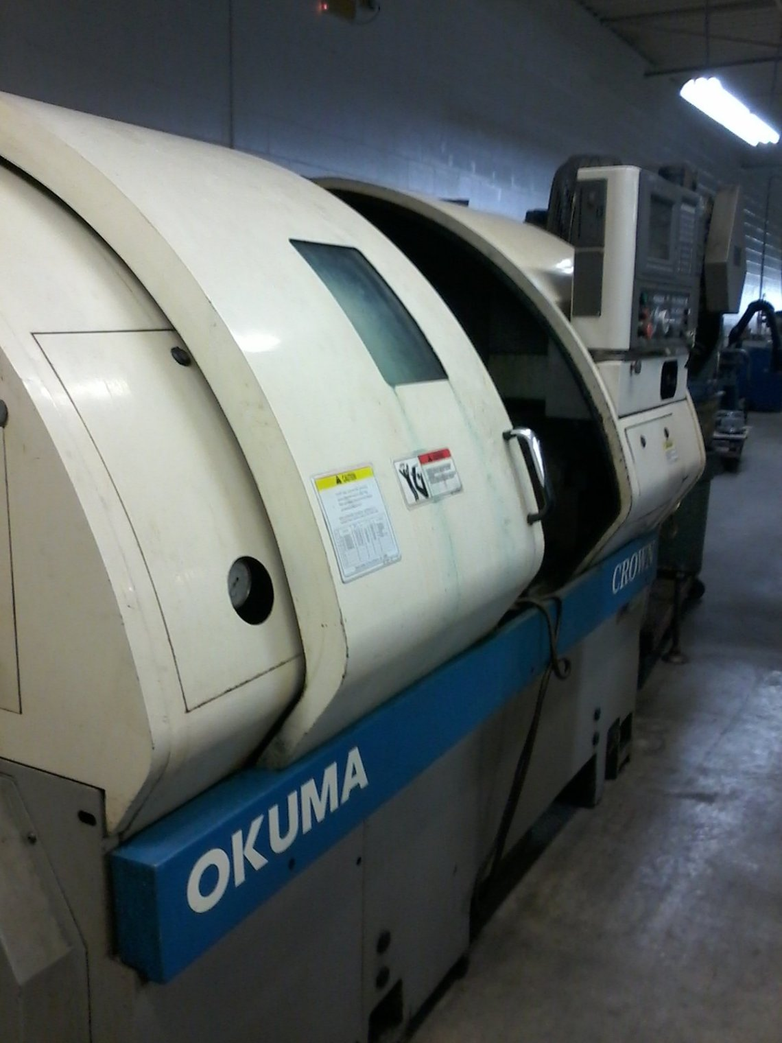 1 – USED OKUMA CROWN 762S CNC LATHE C-5515