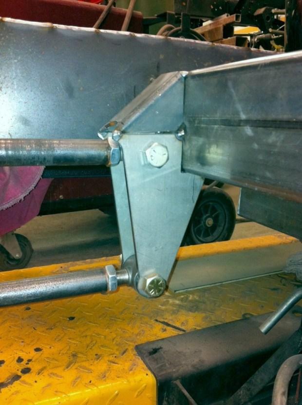 Frame bracket tied in to crossmember