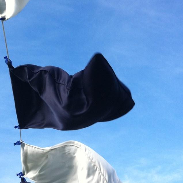 Single dark blue silk pillowcase with hand-rolled edges.