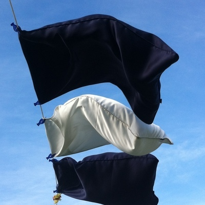 One pair, dark blue, with hand-rolled edges. Standard UK size 50cm x75cm