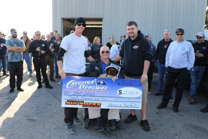 Mr Dent Johnson receives 20k check and trophy at carolina dragway