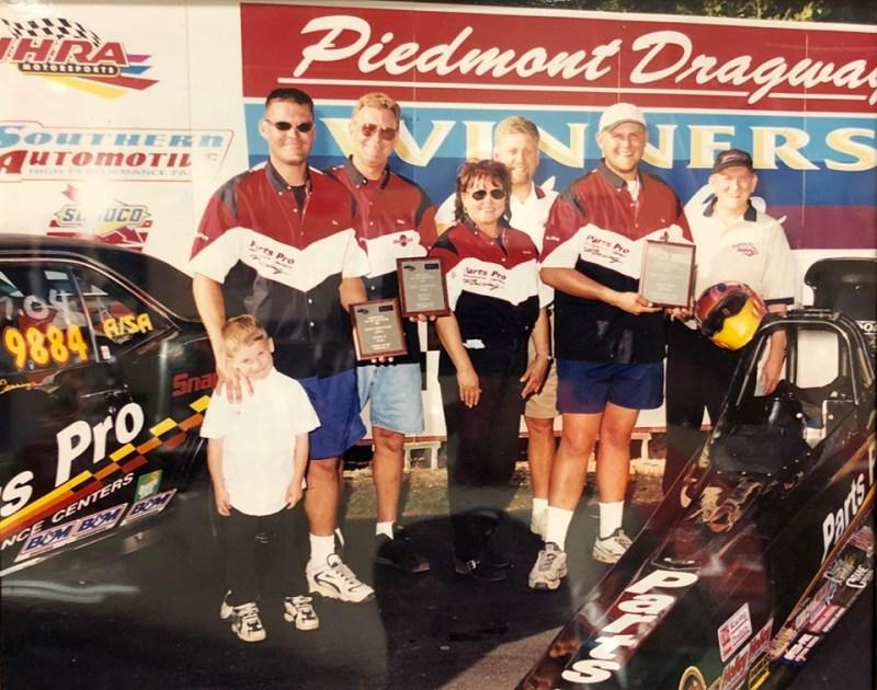 Cummings Motorsports winners circle vintage