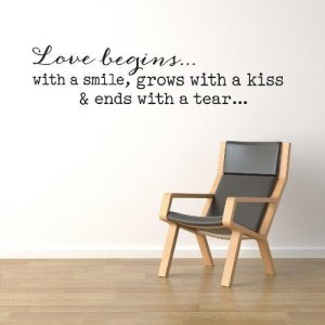 Love Begins with a Smile Wall Quote