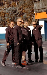 Chris Rini (2nd from right), discusses track conditions with his crew at Piedmont Dragway.
