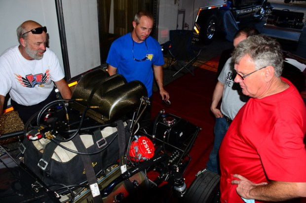 """Bubba Stanton (blue shirt) and car owner Roger Henson (in red) look over """"Spanky,"""" the screw-blown Hemi that propelled Stanton to victory in Pro extreme at the first two PDRA events this season. In testing today (May 22) for the series' third race, Stanton was quickest overall with a 3.589 pass at 215.20 mph."""
