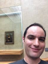 Ian getting a selfie with the lady, Mona Lisa.