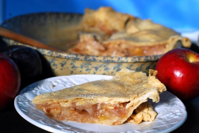 apple plum pie against blue