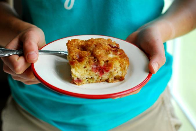 strawberry rhubarb cake in hands