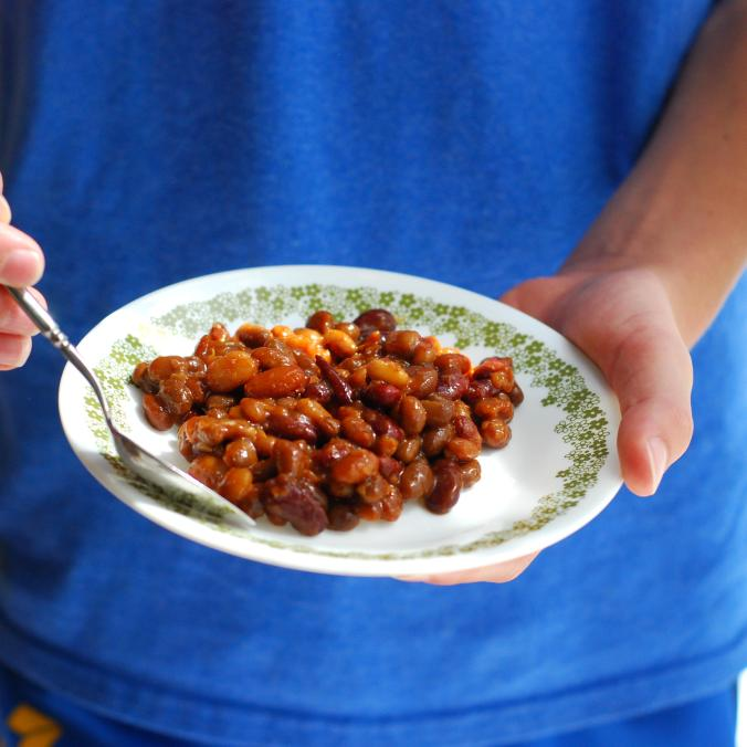 barbecue baked beans in hands