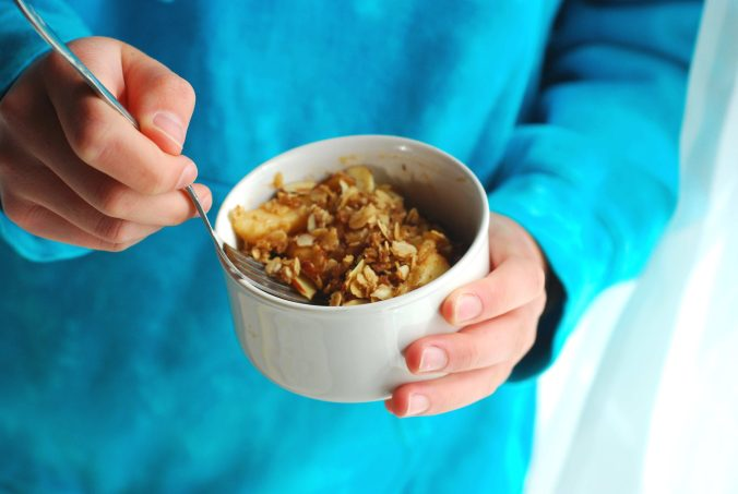 stovetop apple crisp in hands