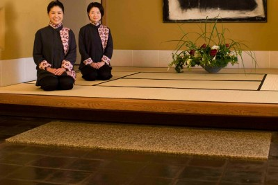 Two women sitting on traditional tatami.