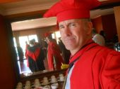 alan professor in red tut