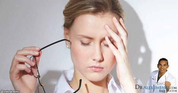 blog picture of lady touching head with headache
