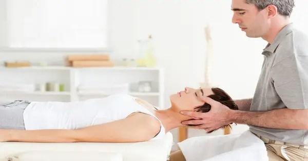 blog picture of chiropractor adjusting patient's neck
