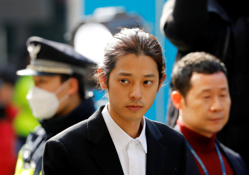 A South Korean singer Jung Joon-young arrives for questioning on accusations of illicitly taping and sharing sex videos on social media, at the Seoul Metropolitan Police Agency in Seoul