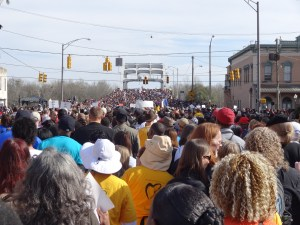80,000 people marched across the Edmund Pettus Bridge on March 8, 2015