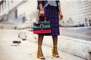 lady with a checked skirt carrying a bag
