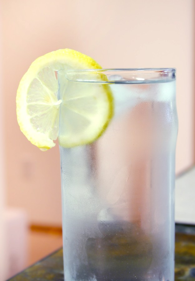 Fasting is so much easier when you drink enough water. Adding lemon to your water is great to help support your liver through a fast. © Johanna Goodyear | Dreamstime Stock Photos