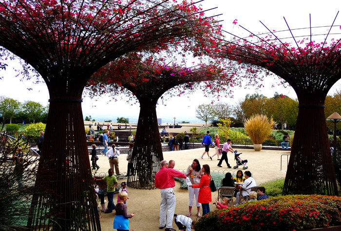 Rebar trees with bougainvillea blossoms. I might try this at home.
