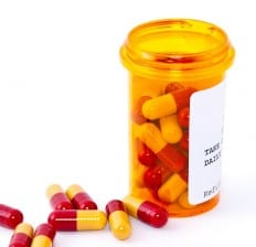 medication bottle with pills
