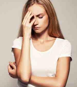 Upset woman. Sad female. Headache