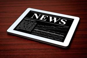 News on digital tablet.