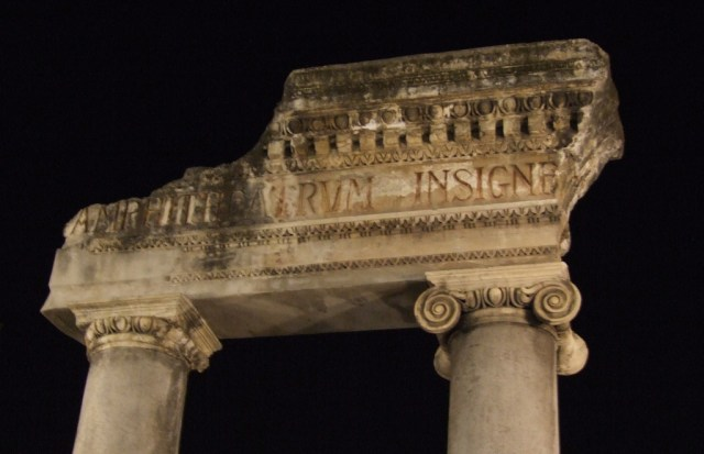 Image of ancient ruins - broken inscribed capital set on top of columns