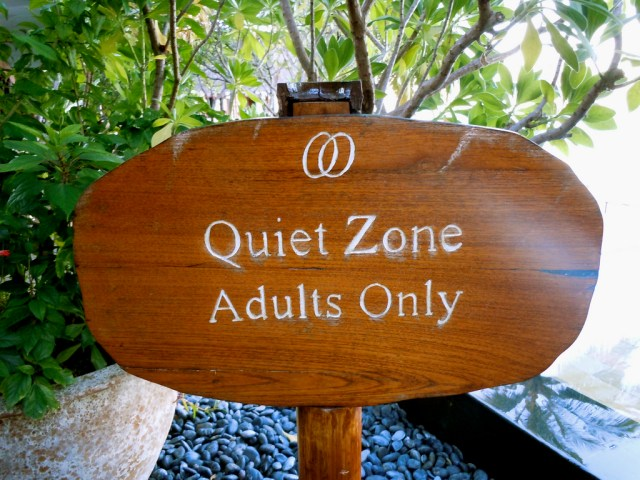 """Quiet Zone Adults Only"" carved onto wooden sign"