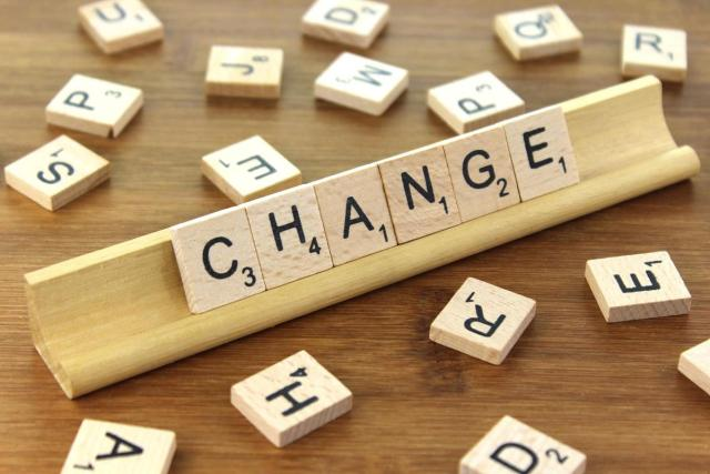 "scrabble tiles spelling ""change"""
