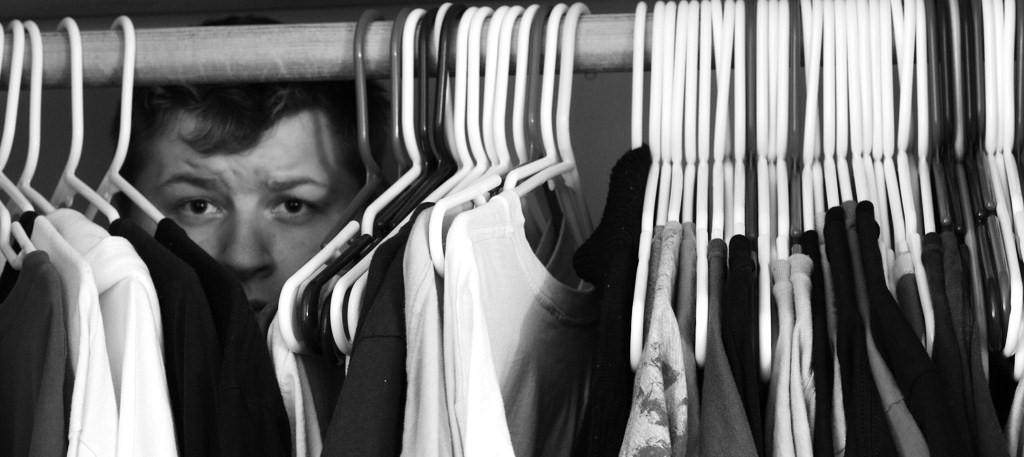 male hiding in closet photo