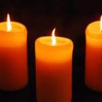three orange candles
