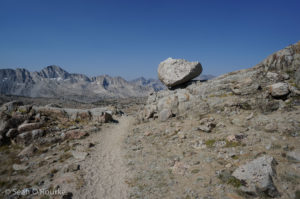 Passing balanced rock headed down Dusy Basin