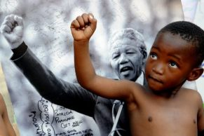 child_imitating_mandela.jpg.size.xxlarge.promo