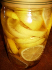 sliced lemons in jar w oil