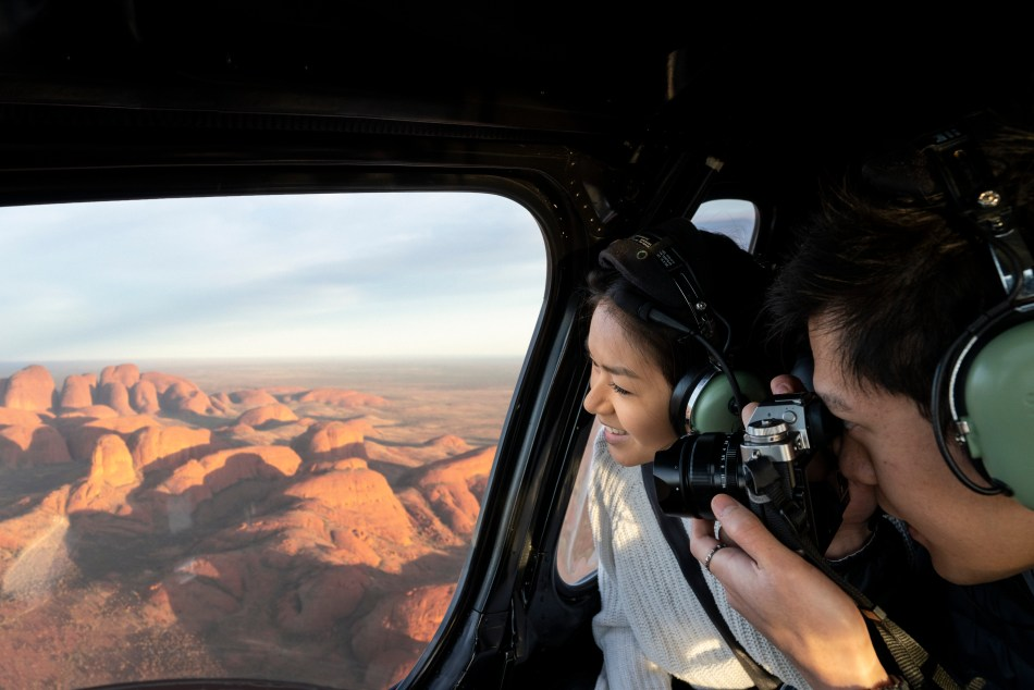 Couple viewing Kata Tjuta from a scenic helicopter flight