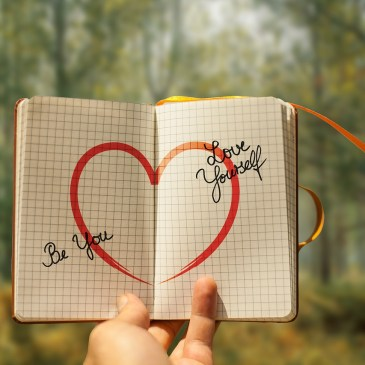 Image of journal with Love Yourself and Be You written in it