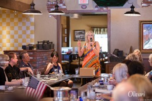 Photo of Mardi doing a presentation for networking group