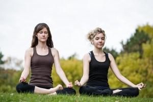 meditating-585x390