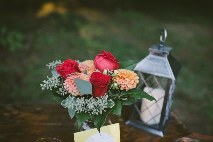 wedding ceremony, elope in michigan, flowers and lantern on a table at a backyeard wedding by a saugatuck wedding planner