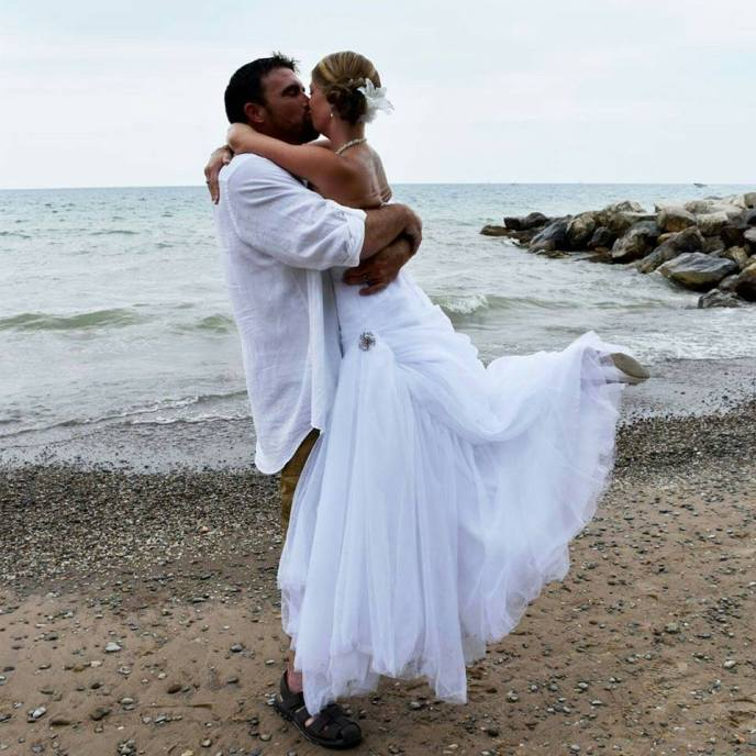 simple wedding on the beach with couple embracing