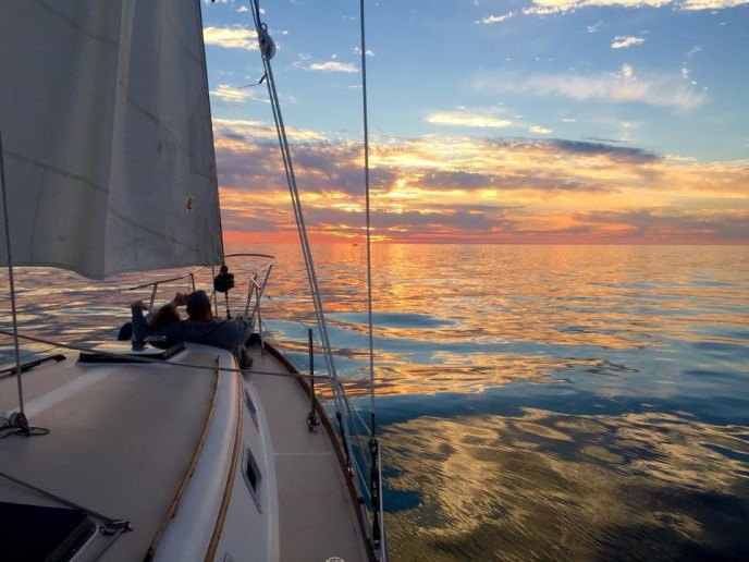 Sail Boat Wedding at Sunset shot from aboard, elope in South Haven