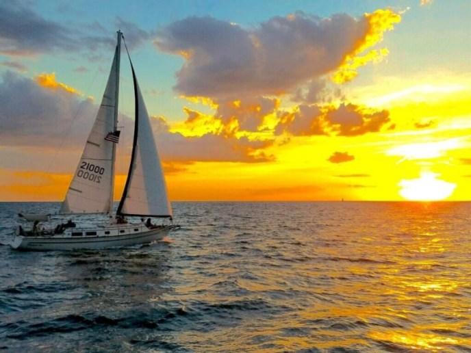 Sailboat Wedding at Sunset taken from shore, lake michigan wedding