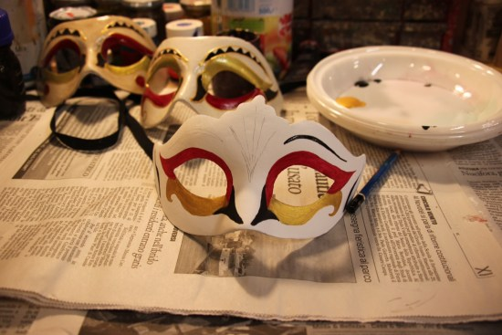 Designing the decoration for a hand painted Venetian mask