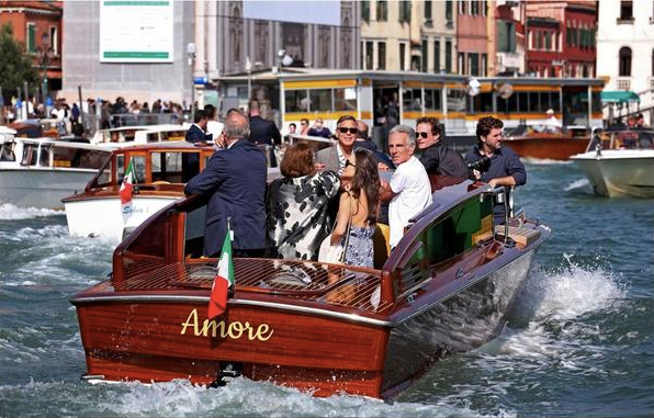 "George and Amal aboard the water taxi ""Amore"" on the Grand Canal"