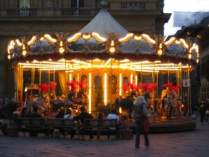 Spinning around on a merry-go-round in Florence