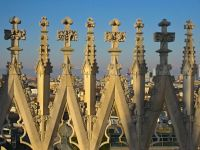 Detail of the stone spires rising above the gothic Duomo in Milan, Italy