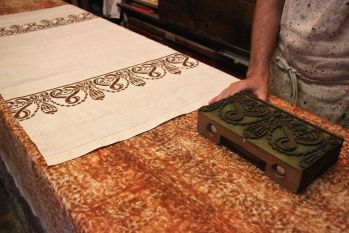 The intricate design transfers from the wooden block to the fabric