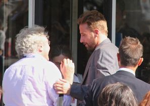 Matthias Schoenaerts chats to a fan before posing for a selfie with him outside the Excelsior Hotel on the Venice Lido