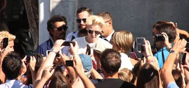 Tilda Swinton patiently signs for and poses with waiting fans at the Venice Film Festival 2015